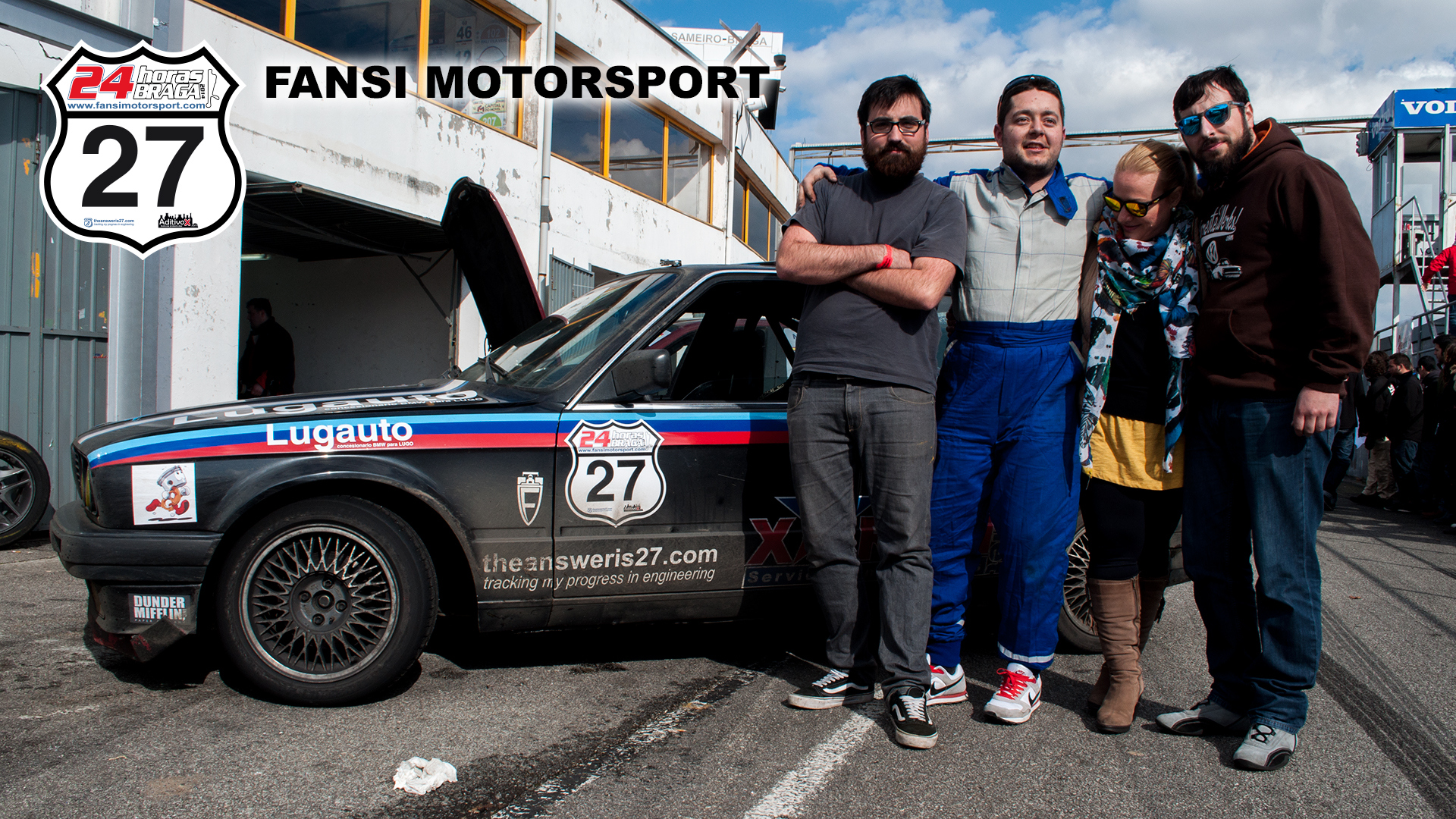 """Figure 1. Four of the five drivers/mechanics/petrolheads of the team [left to right: Noel """"the Stig(ster)"""" García, Ángel Nieto, Ana Castellano, and Víctor Ibáñez]. None of the them is me; but this blog is on the door."""