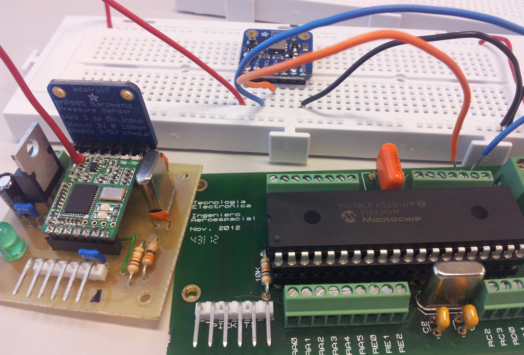 Figure 1. The BMP085 barometric pressure sensor, a RF module, a protoboard and the mighty PIC18F4520